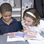Propel East students reading a book